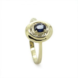 A Charming Oval Sapphire Diamond Halo Ring