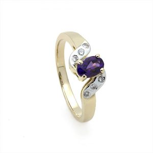 A Stylish Oval Amethyst and Diamond Ring