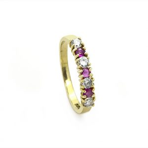 A Dainty Red Ruby And Diamond ring